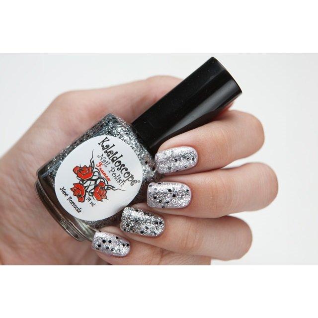 El Corazon, Kaleidoscope Кружева и пайетки № 09Лаки Kaleidoscope<br>Лак для ногтей прозрачный, с мелкими серебрянными блестками и крупнымичерными.14 ml.<br>